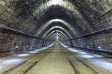 A train disappearing into a tunnel