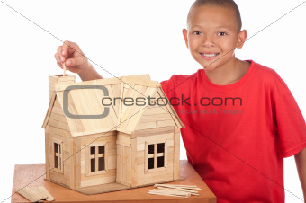 Boy builds popsicle house