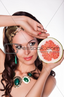 Beautiful Brunette Holding Half of fresh Grapefruit - Preference of Healthy Food