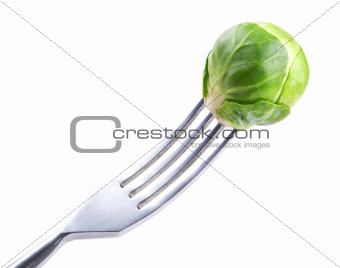 fork with fresh green Brussels sprouts
