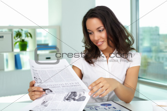 Businesswoman reading news