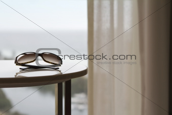 Contemporary apartment with sunglasses and view