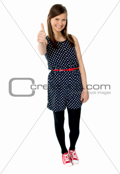 Cheerful teenager gesturing thumbs up
