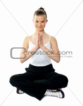 Pretty girl doing yoga in lotus pose