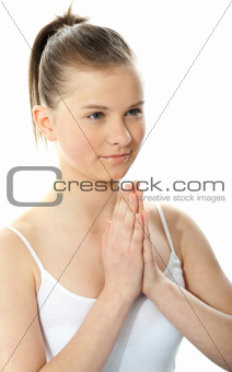 Young girl doing yoga moves and meditating
