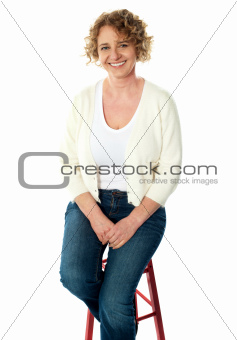 Full length view of seated senior woman