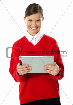 School girl holding tablet computer