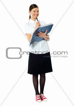School girl thinking and smiling at camera