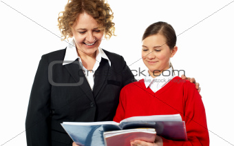 Teacher helping teen student one on one