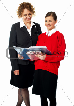 Beautiful child with teacher, shot in studio