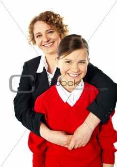 Teacher embracing her student from back