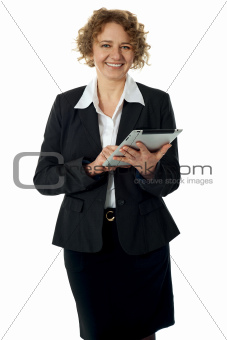 Curly haired woman posing with touch pad device