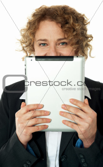 Corporate lady hiding her face with wireless device