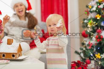 Baby girl enjoying Christmas cookies