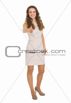 Happy young woman stretching hand for handshake