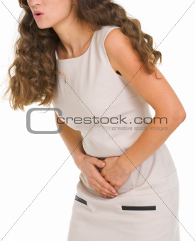 Closeup on woman having stomach pain