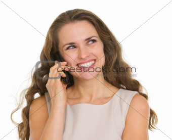 Smiling woman talking mobile phone and looking on copy space