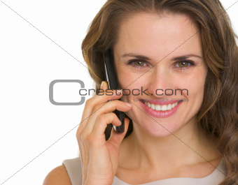 Portrait of beautiful young woman having mobile phone call