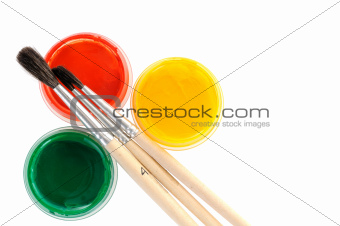 Paints with paint brushes over white background