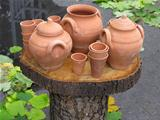 Clay pots on wooden support over autumn background