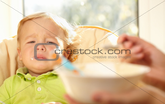 Kid is very disappointmented about porridge.
