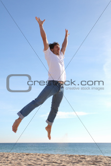 Man jumping happy in the beach