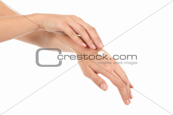 Woman moisturizing her hands