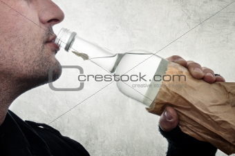 Man drinking vodka from bottle