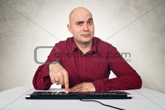 man with computer keybaord