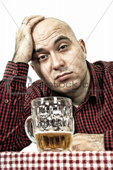 Sad beer drinker