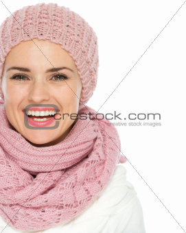 Closeup on smiling woman in knit winter clothes