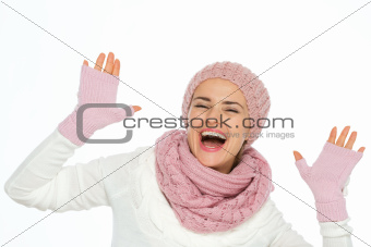 Portrait of cheerful woman in knit scarf, hat and mittens