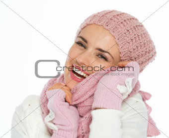 Happy young woman in winter clothes enjoying knit scarf