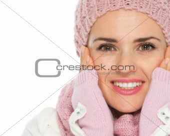 Closeup on happy woman in knit scarf and mittens