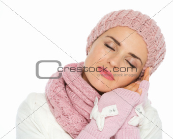 Portrait of dreaming woman in knit winter clothes