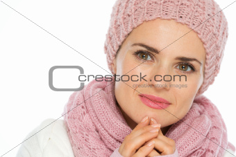 Portrait of thoughtful young woman in knit winter clothes