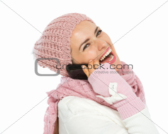Happy woman in knit winter clothing speaking mobile