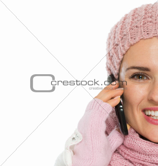 Closeup on happy woman in knit winter clothing speaking mobile