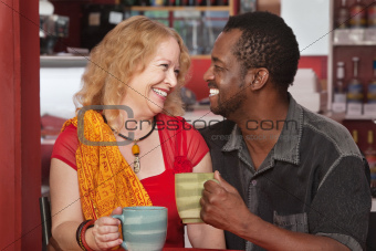 Smiling Mixed Couple Having Coffee