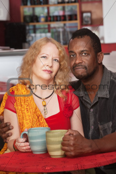 Calm Mixed Couple with Mugs