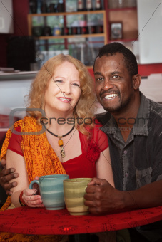 Happy Mixed Couple in Coffeehouse