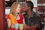 Smiling Mixed Couple in Cafe