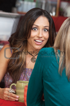 Shocked Woman with Smile in Cafe