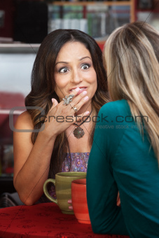 Hispanic Woman with Friend in Cafe