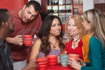 Attractive Ladies with Men in Cafe