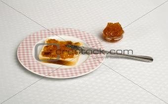 Spread jam on bread