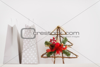 Closeup on shopping bags and Christmas decorative tree