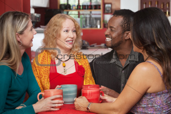 Joyful Group of Four in Cafe