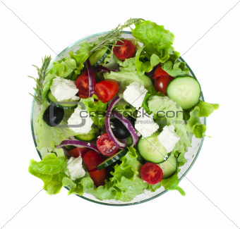 Salad in a glass bowl on a white background