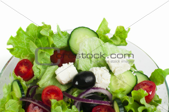 Salad in a glass bowl close up